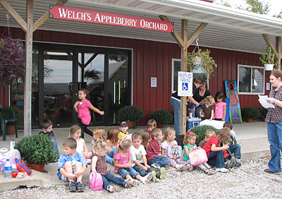 Kids enjoy and learn on their field trip to Appleberry Orchard, seeing how apples and berries are grown and harvested, taking a wagon ride, and visiting the petting farm and play area.